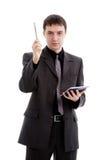 Homem novo em um terno com um bloco de notas e uma pena à disposicão Fotografia de Stock