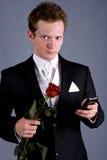 Homem novo em um terno preto Imagens de Stock