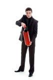 Homem novo em um terno que prende um extintor de incêndio. Imagens de Stock Royalty Free