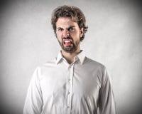 Homem novo enojado Imagem de Stock