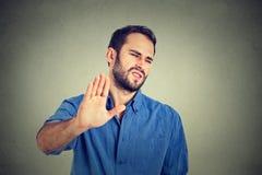 Homem novo enojado Emoção humana negativa Imagem de Stock Royalty Free