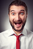 Homem novo Excited com barba Imagem de Stock Royalty Free