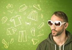 Homem novo feliz com ícones dos vidros e da roupa ocasional Imagem de Stock Royalty Free