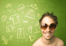 Homem novo feliz com ícones dos vidros e da roupa ocasional Fotografia de Stock