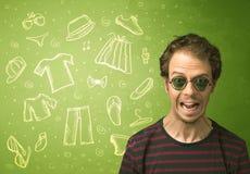 Homem novo feliz com ícones dos vidros e da roupa ocasional Fotos de Stock Royalty Free