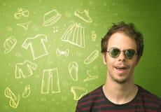 Homem novo feliz com ícones dos vidros e da roupa ocasional Imagens de Stock Royalty Free