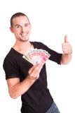 Homem novo feliz com dinheiro em suas mãos imagem de stock royalty free