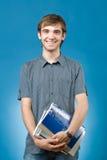 Homem novo feliz com livros Fotos de Stock Royalty Free