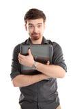 Homem novo feliz com portátil fotografia de stock