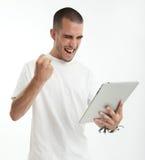 Homem novo feliz com tabuleta Fotografia de Stock