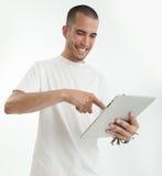 Homem novo feliz com tabuleta Foto de Stock
