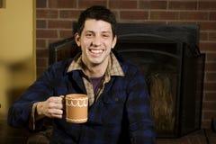 Homem novo feliz estar para dentro Imagens de Stock Royalty Free