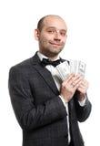 Homem novo feliz, homem de negócios com dinheiro à disposição imagens de stock royalty free