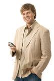 Homem novo feliz que usa o móbil Fotos de Stock Royalty Free