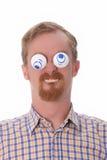 Homem novo muito engraçado com brinquedos Fotografia de Stock Royalty Free