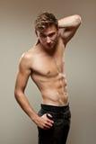 Homem novo muscular Fotos de Stock Royalty Free