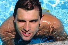 Homem novo na água foto de stock royalty free