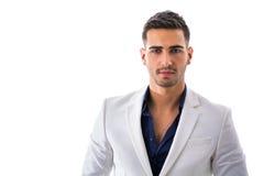 Homem novo na camisa azul e no revestimento branco isolados Imagem de Stock Royalty Free