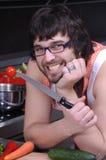 Homem novo na cozinha Fotos de Stock