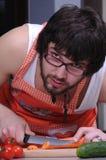 Homem novo na cozinha Imagens de Stock