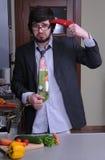 Homem novo na cozinha cuffed Fotografia de Stock