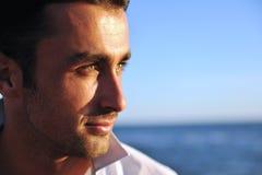 Homem novo na praia Fotografia de Stock