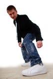 Homem novo nas sapatilhas Fotografia de Stock Royalty Free