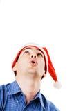 Homem novo no chapéu de Santa Imagens de Stock Royalty Free