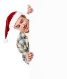 Homem novo no chapéu de Santa Fotos de Stock Royalty Free