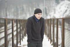 Homem novo no inverno Fotos de Stock Royalty Free