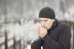 Homem novo no inverno Fotografia de Stock Royalty Free