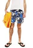 Homem novo no short com toalha Foto de Stock