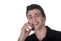 Homem novo no telefone Foto de Stock Royalty Free