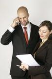 Homem novo no telefone com assistente Imagem de Stock Royalty Free