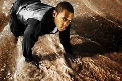 Homem novo no terno com água Fotos de Stock Royalty Free