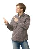 Homem novo ocasional que aponta ao espaço em branco Foto de Stock Royalty Free