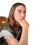 Homem novo pensativo Imagem de Stock