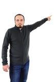 Homem novo que aponta no ar Foto de Stock