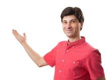 Homem novo que apresenta algo Imagem de Stock Royalty Free
