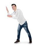 Homem novo que apresenta algo Fotografia de Stock