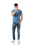 Homem novo que comprime seu nariz Foto de Stock Royalty Free