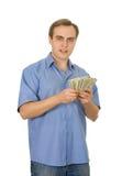 Homem novo que conta o dinheiro. Isolado no branco. Fotografia de Stock