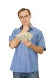 Homem novo que conta o dinheiro. Isolado no branco. Fotos de Stock