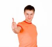 Homem novo que dá o polegar acima foto de stock