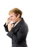Homem novo que fala no telefone Imagem de Stock