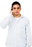 Homem novo que fala no telefone Imagens de Stock Royalty Free