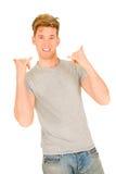 Homem novo que faz a cair sinais de mão frouxos fotos de stock