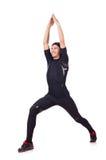 Homem novo que faz exercícios Imagem de Stock