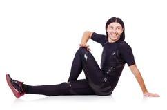 Homem novo que faz exercícios Imagens de Stock