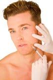 Homem novo que faz injeções do botox Foto de Stock Royalty Free